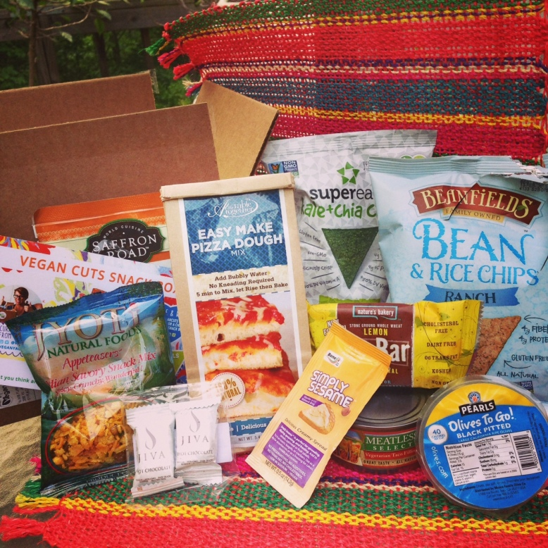 My awesome May Snack Box. If you look closely you can see one of the items didn't even last long enough to get the picture taken before I started crunching on it!